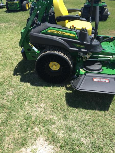 [Image: Our newest mower with the new tweels, no flats, and less stress on turf!]